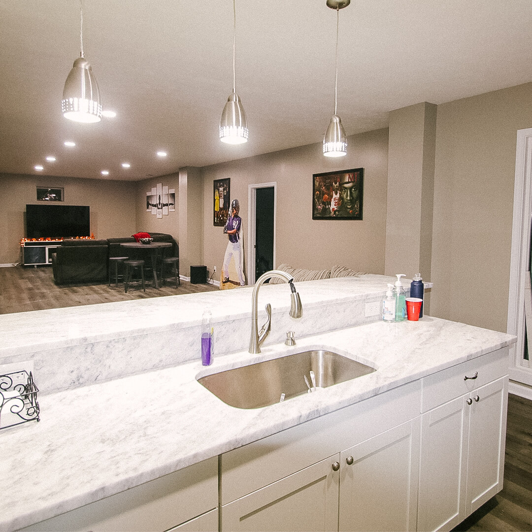 Indian Hills, Indiana basement remodel Bar and sink with marble countertops - construction by Modern Touch Contracting