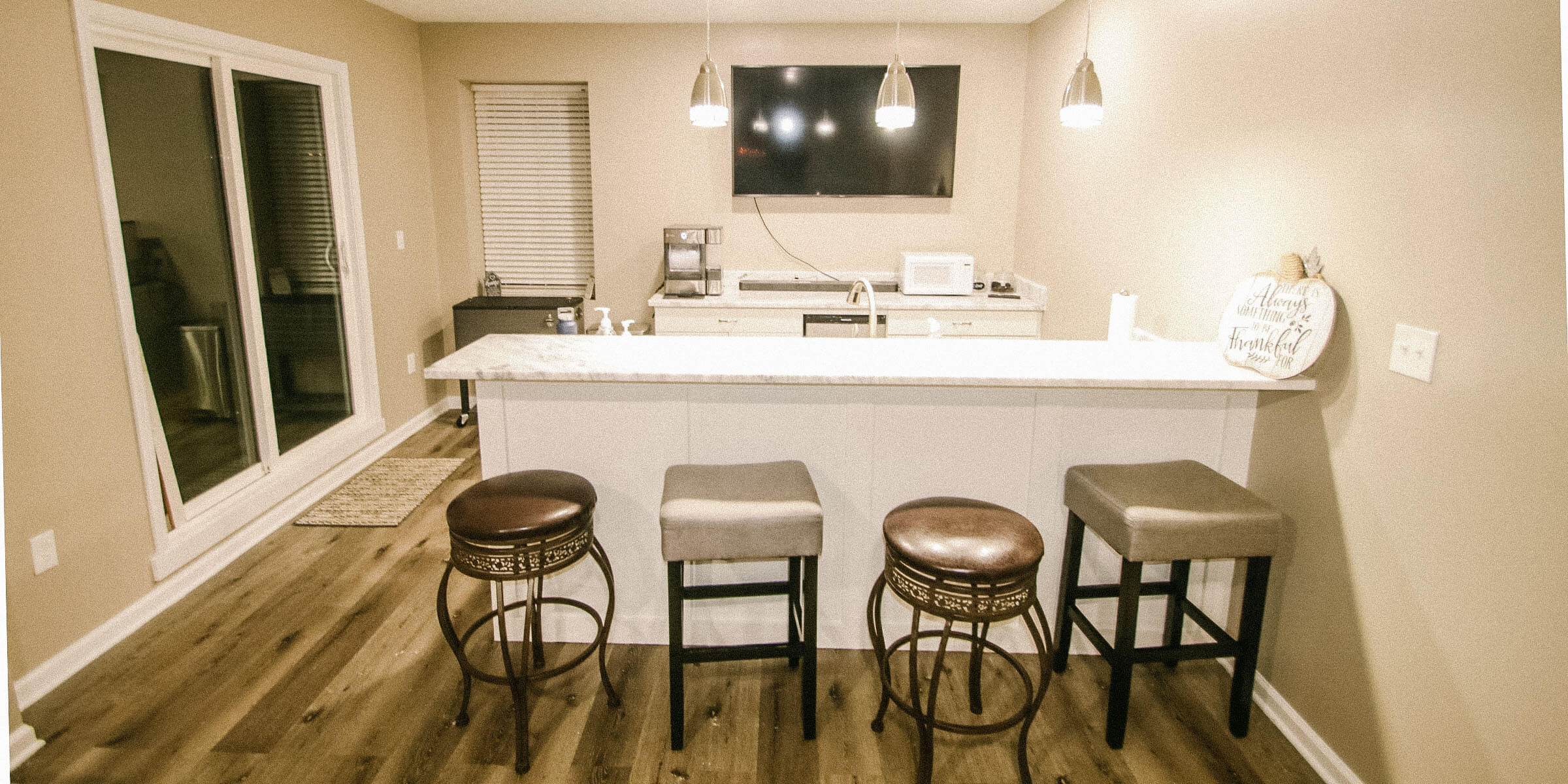 Indian Hills, Indiana basement remodel Bar and sliding glass doors construction by Modern Touch Contracting