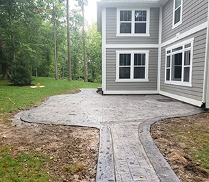 Indianapolis Sunrooms and Indianapolis Outdoor living - stamped concrete in the backyard in a home in Avon